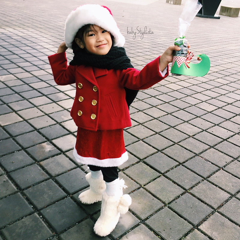Little Mama Gives Back :: Teaching The Gift of Giving at Christmas (With Elf Feet)